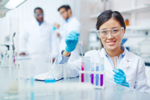 Young laboratory worker looking at camera